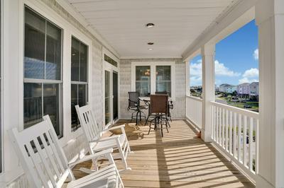 7408 E BEACH DR, Oak Island, NC 28465 - Photo 2