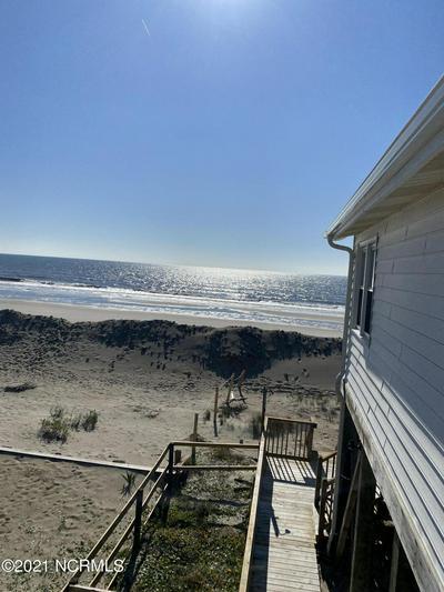 3221 E BEACH DR, Oak Island, NC 28465 - Photo 1