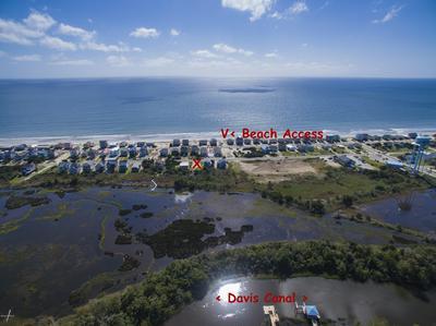 306 E DOLPHIN DR, Oak Island, NC 28465 - Photo 1