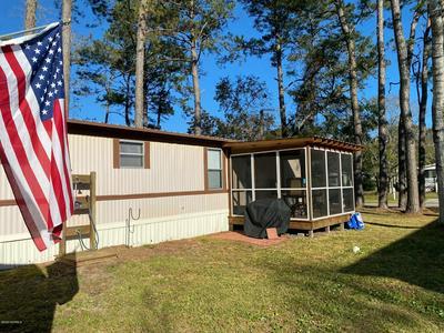 247 NE 67TH ST, Oak Island, NC 28465 - Photo 1