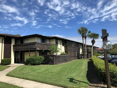 60 CLUB HOUSE DR APT 102, PALM COAST, FL 32137 - Photo 1