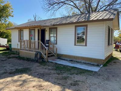 1002 W COLLEGE AVE, Comanche, TX 76442 - Photo 1