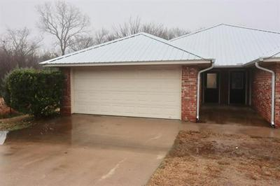 1124 W SPRING ST, Weatherford, TX 76086 - Photo 1