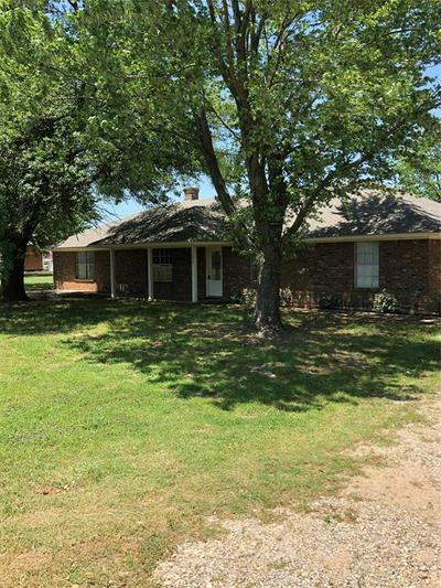 705 E WOODLAND ST, Collinsville, TX 76233 - Photo 1