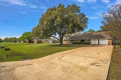 718 S HOUSTON ST, EDGEWOOD, TX 75117 - Photo 2
