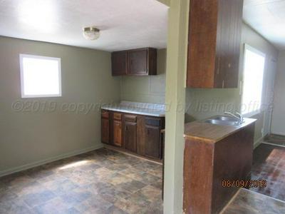 829 S WILHELM AVE, Stinnett, TX 79083 - Photo 2