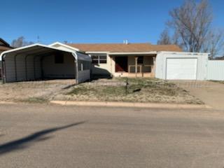 316 S WILHELM AVE, Stinnett, TX 79083 - Photo 1