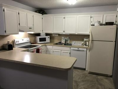 5680 SE WINDSONG LN, Stuart, FL 34997 - Photo 2