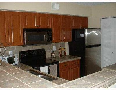 1715 VILLAGE BLVD APT 101, West Palm Beach, FL 33409 - Photo 2