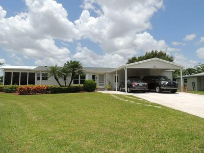 8129 9TH HOLE DR, Port Saint Lucie, FL 34952 - Photo 1