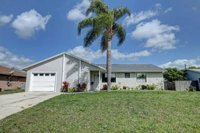 571 SE CRESCENT AVE, PORT SAINT LUCIE, FL 34984 - Photo 1