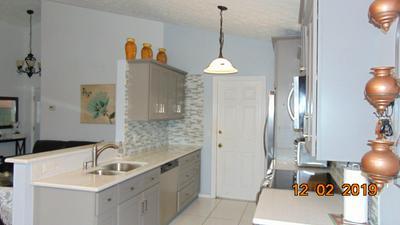 509 SE BERRY AVE, Port Saint Lucie, FL 34984 - Photo 1