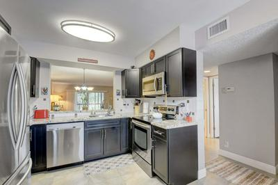 7281 AMBERLY LN APT 208, Delray Beach, FL 33446 - Photo 1