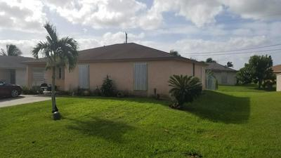 1598 N BAINES TER, PAHOKEE, FL 33476 - Photo 1