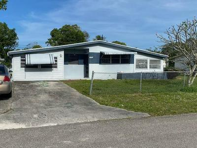 1619 SE ARAPAHO AVE, STUART, FL 34994 - Photo 1