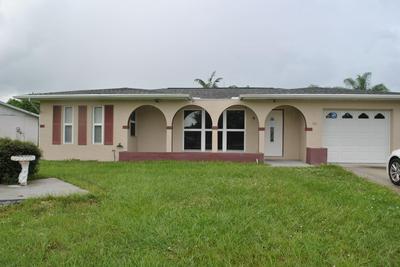 106 SE CALMOSO DR, Port Saint Lucie, FL 34983 - Photo 1