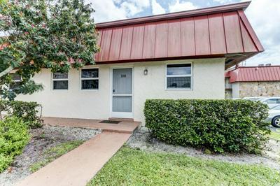 12019 W GREENWAY DR APT 108, Royal Palm Beach, FL 33411 - Photo 1