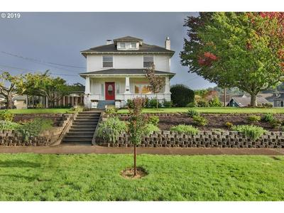 572 E 1ST ST, COQUILLE, OR 97423 - Photo 1