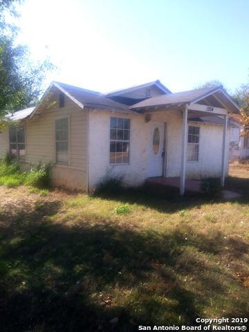 1204 W COLORADO ST, PEARSALL, TX 78061 - Photo 1
