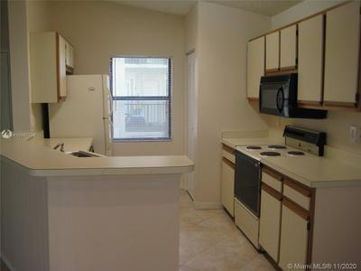 9999 SUMMERBREEZE DR APT 1112, Sunrise, FL 33322 - Photo 1