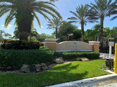 8891 WILES RD APT 205, Coral Springs, FL 33067 - Photo 1