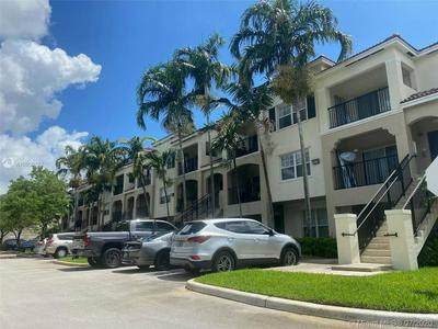 5960 W SAMPLE RD APT 306, Coral Springs, FL 33067 - Photo 1
