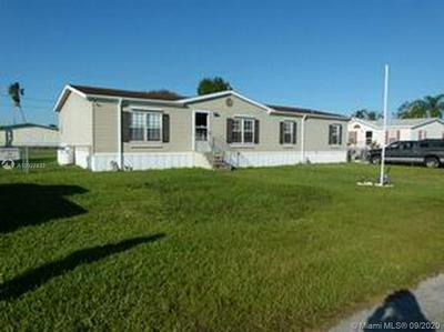 1054 ANDREA LN, Bulkhead Ridge, FL 34974 - Photo 1