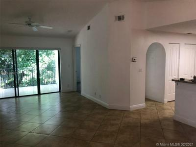 10155 W SUNRISE BLVD APT 304, Plantation, FL 33322 - Photo 2