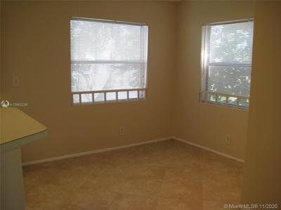 9999 SUMMERBREEZE DR APT 1112, Sunrise, FL 33322 - Photo 2