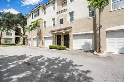 5880 W SAMPLE RD APT 203, Coral Springs, FL 33067 - Photo 1