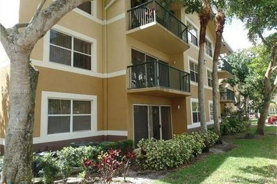 8781 WILES RD APT 203, Coral Springs, FL 33067 - Photo 1