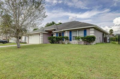 1065 SW JANAR AVE, Port St. Lucie, FL 34953 - Photo 1