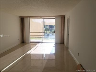 8450 SUNRISE LAKES BLVD APT 202, Sunrise, FL 33322 - Photo 1