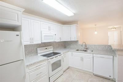 11263 W ATLANTIC BLVD APT 203, Coral Springs, FL 33071 - Photo 1