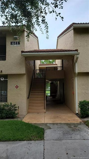611 LYONS RD APT 8208, Coconut Creek, FL 33063 - Photo 2