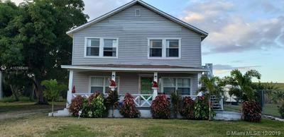 1021 E MAIN ST, PAHOKEE, FL 33476 - Photo 1