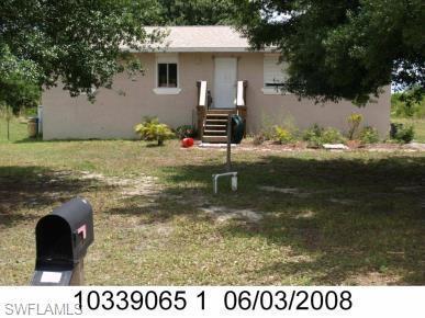 3303 18TH ST SW, LEHIGH ACRES, FL 33976 - Photo 1