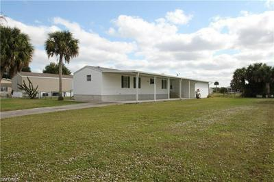 1083 W MILLER DR, MOORE HAVEN, FL 33471 - Photo 1