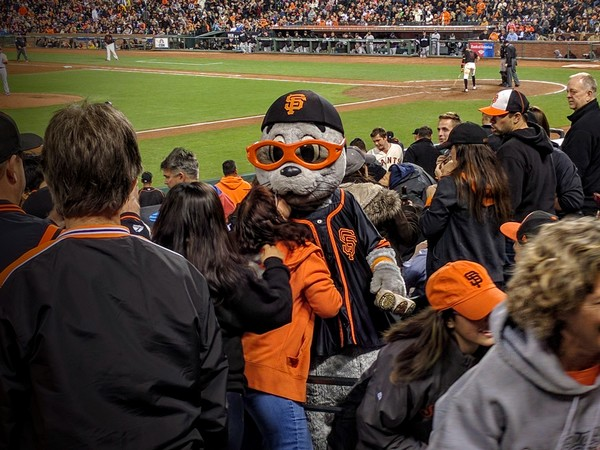 Giants mascot Lou Seal pays my mom and me a visit at the game.