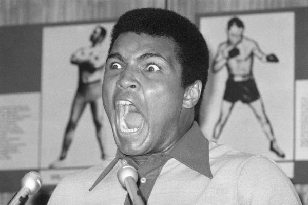 Muhammad Ali yells during a news conference in New York, 1974. (Ron Frehm/AP)