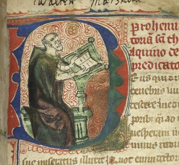 St. Thomas Aquinas in a manuscript.
