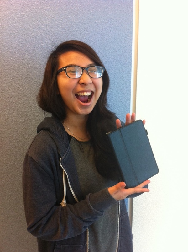 Oakland student Chi likes her Kindle. Donate $10 to paypal.me/kcp so she can request another book to read!