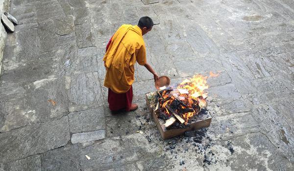 A monk participates in a monastery festival in Pemba Sherpa's hometown in Phaplu, Nepal