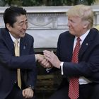 Trump's uncomfortably long handshake with Shinzō Abe was a power play, according to a body language expert — Quartz
