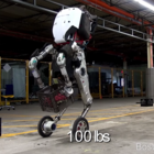 Boston Dynamics' new robot can jump 4 ft, lift 100 lbs, and skate on 2 wheels