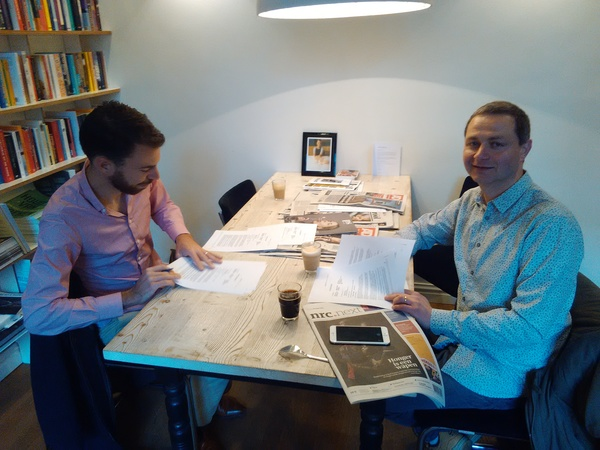 Co-author Matthijs (left) and me signing our book deal (photo: Pim van Tol)