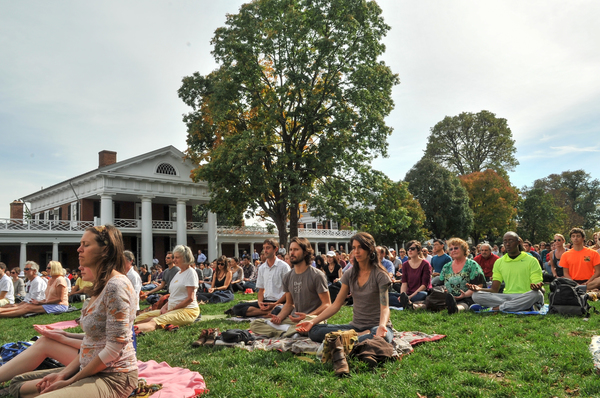 Somewhere in between 'alone in a crowd' and 'one with the universe', Arianna Huffington and Deepak Chopra lead meditation at University of Virginia (2013)
