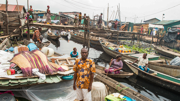 Slum Dwellers In Lagos, Africa's Biggest Megacity, Are Now Living In Canoes : Goats and Soda : NPR