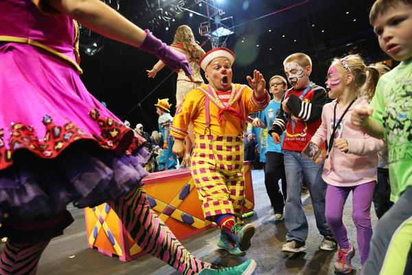 Clown Gabor Hrisafis dances with children during the all-access pre-show.