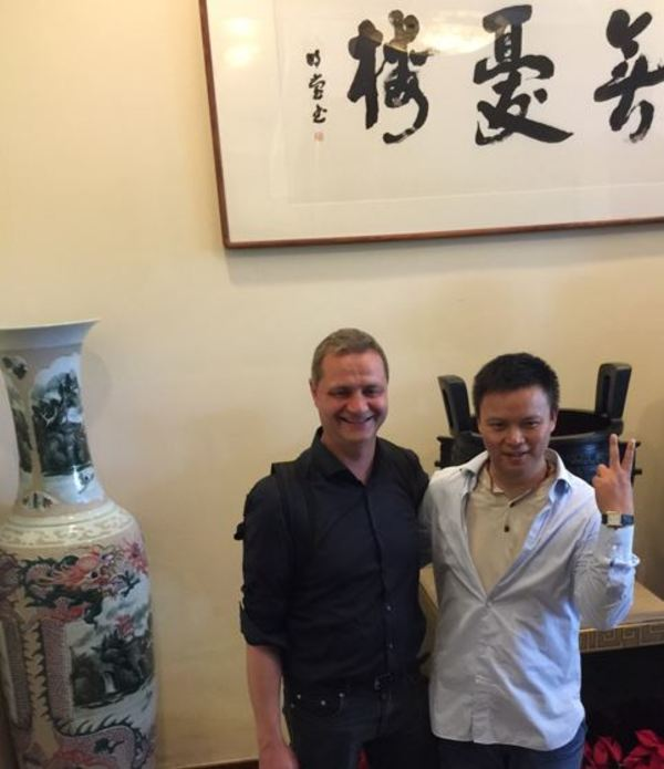 Mr Lou (right) in Hangzhou turned from asset manager to games developer. We are standing in front of a calligraphy by his hand stating his life philosophy: don't worry :-)